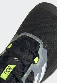 adidas Performance - TERREX TWO FLOW - Stabilty running shoes - savannah/core black/hi-res yellow - 9