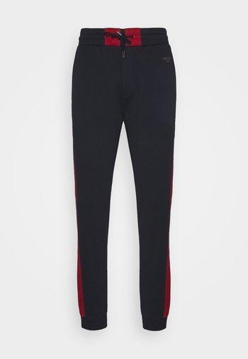 Teplákové kalhoty - ink/bally red