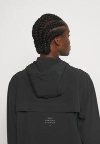 Nike Performance - RUN - Sports jacket - black/bright crimson - 3