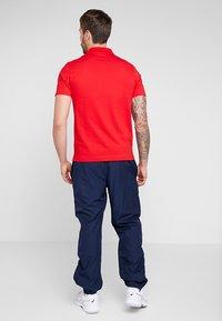 Lacoste Sport - TENNIS PANT - Pantalon de survêtement - navy blue - 2