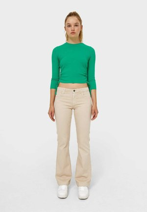 SCHLAGHOSE  - Flared Jeans - stone