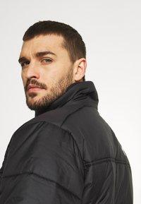 The North Face - SAIKURU JACKET - Winter jacket - black - 3