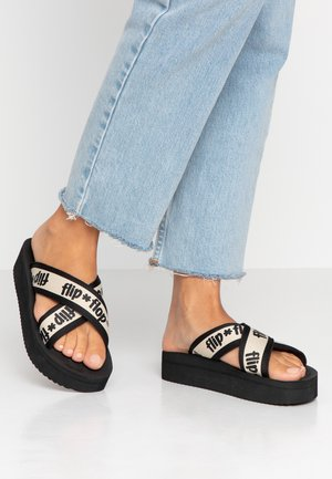 CROSS TAPE HI - Mules - black