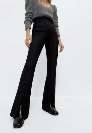 MIT SCHLITZ 00111263 - Trousers - black