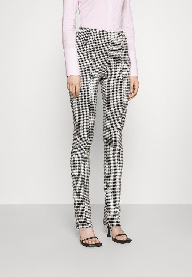 PANTS - Spodnie materiałowe - black/white