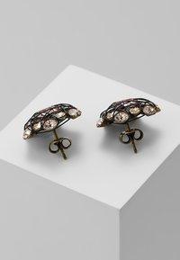 Konplott - EARRING STUD BENDED LIGHTS - Earrings - beige antique - 2