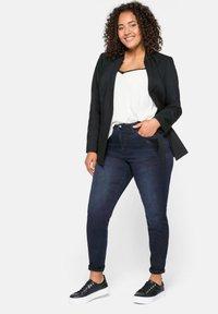 Sheego - Slim fit jeans - blue black denim - 1