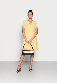 Moss Copenhagen - LINOA RIKKELIE WRAP DRESS - Day dress - banana - 1