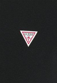 Guess - SCOTT - Polo shirt - jet black - 7