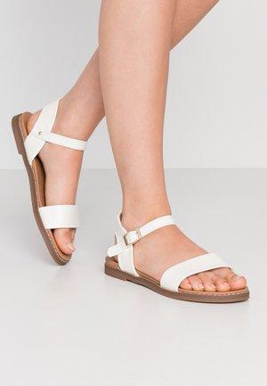 GOLDIE - Sandaalit nilkkaremmillä - white