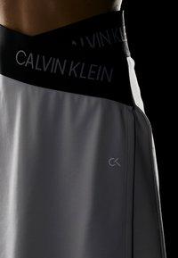 Calvin Klein Performance - ASYMMETRIC SKIRT - Sports skirt - white - 4