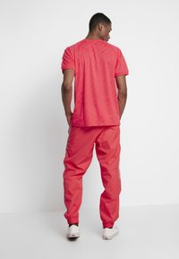 adidas Originals - LOCK UP - Trainingsbroek - flash red - 2