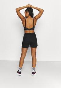triaction by Triumph - CARDIO CLOUD - High support sports bra - black - 3