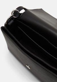 Calvin Klein - FLAP SHOULDER BAG - Handbag - black - 2