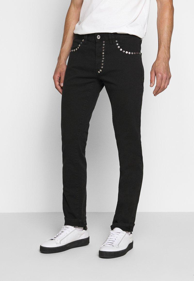 Just Cavalli - PANTALONE - Slim fit jeans - black