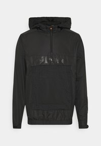 LIOM - Windbreaker - black