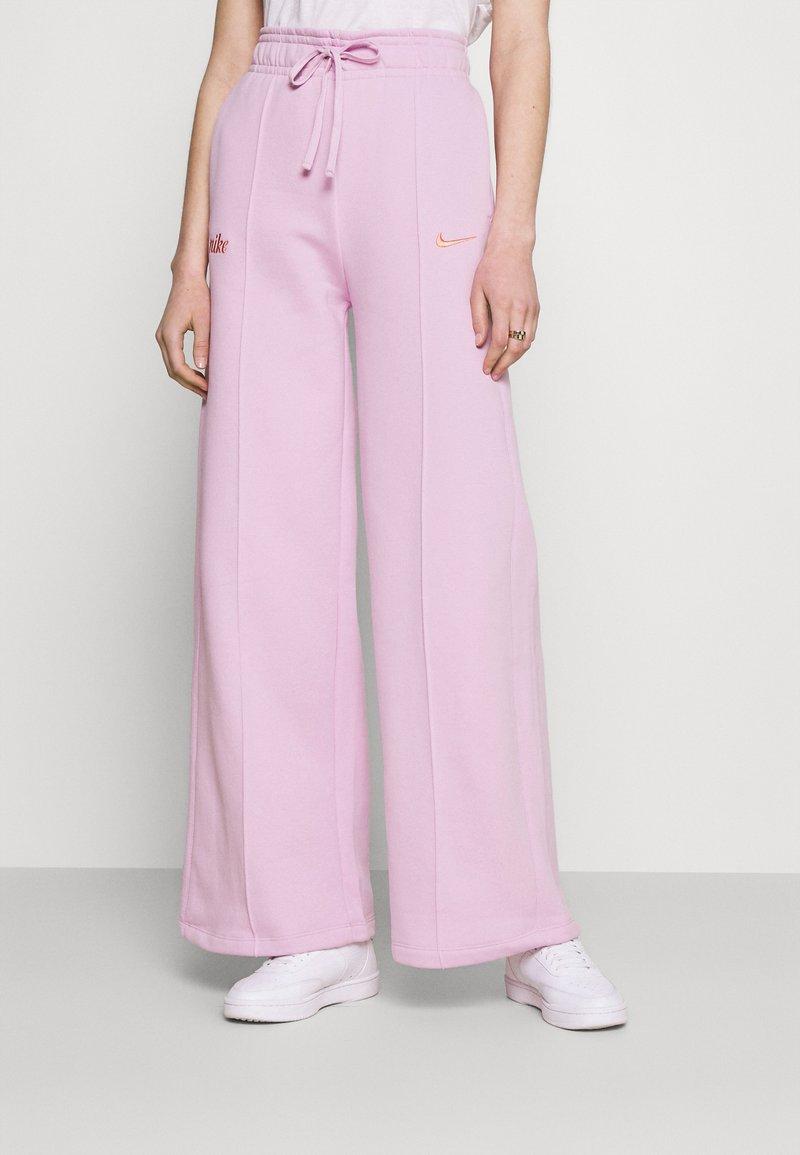 Nike Sportswear - PANT - Tracksuit bottoms - light arctic pink