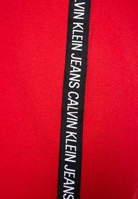 Calvin Klein Jeans - TAPE LOGO DRESS - Jersey dress - barbados cherry - 5