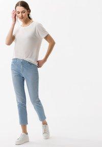 BRAX - STYLE CARO  - Slim fit jeans - used light blue - 1