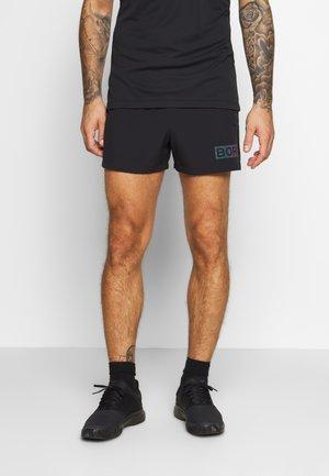 ARTHUR SHORTS - Sports shorts - black radiate