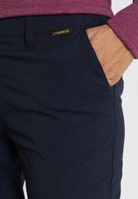 Jack Wolfskin - DESERT ROLL UP PANTS - Outdoorbroeken - midnight blue - 3