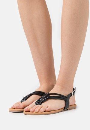 PLAITED - Flip Flops - black