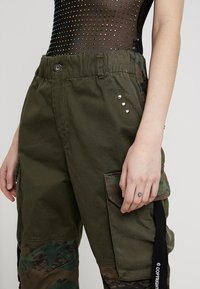 Diesel - THENA TROUSERS - Trousers - olive - 3