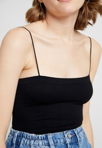 BDG Urban Outfitters - BUNGEE STRAP TUBE - Top - black - 5