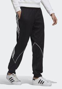 adidas Originals - BIG TREFOIL ABSTRACT POLYESTER TRACKSUIT BOTTOM - Tracksuit bottoms - black - 3