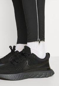 Nike Performance - ELITE PANT TRAIL - Pantalones deportivos - black/white - 3