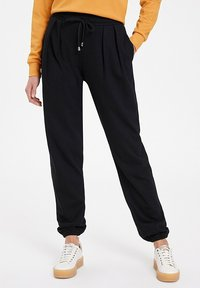 WESTMARK LONDON - Tracksuit bottoms - black - 0