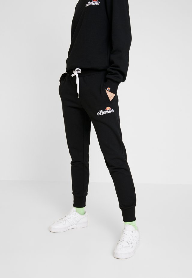 FRIVOLA - Tracksuit bottoms - black