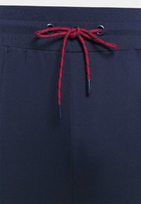 Fila - PALTI  PANTS - Teplákové kalhoty - black iris/true red/bright white - 5