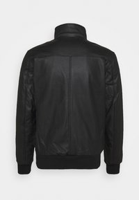HARRINGTON - JAKE - Veste en similicuir - black