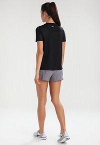 Nike Performance - DRY MILER - Basic T-shirt - black/reflective silver - 2