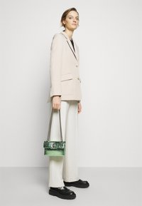 Kurt Geiger London - MINI KENSINGTON BAG - Across body bag - pale green - 0
