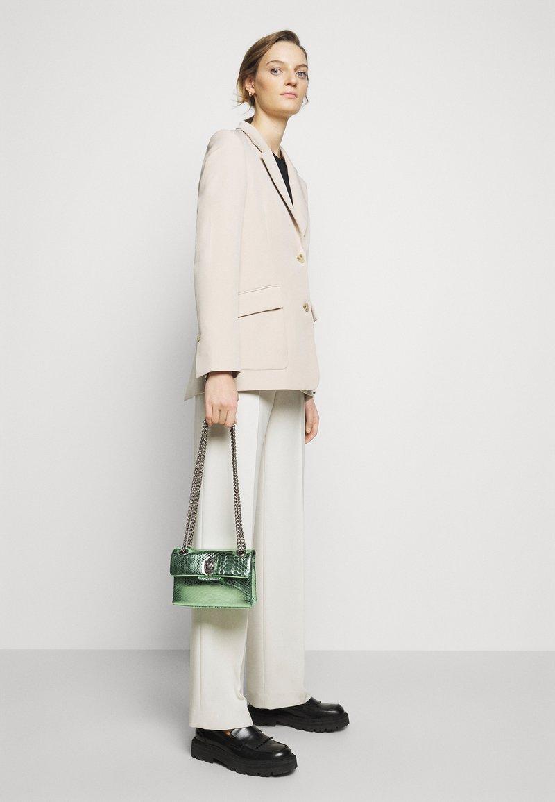 Kurt Geiger London - MINI KENSINGTON BAG - Across body bag - pale green