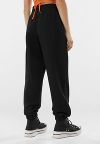 Bershka - Tracksuit bottoms - black - 2