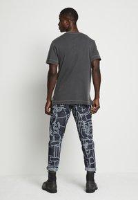 G-Star - REFLECTIVE LOGO LOOSE OD R T S\S - T-shirt z nadrukiem - compact black - 3
