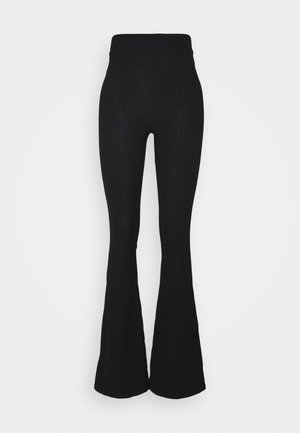 FLARED PANTS - Joggebukse - black