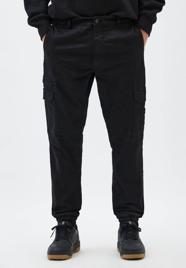 Reisitaskuhousut - mottled black