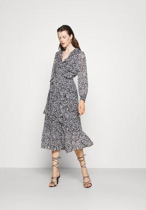 BICOLOR HIPPIE WRAP  - Maxi dress - black/white