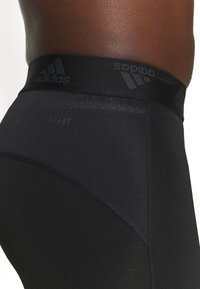 adidas Performance - 3 STRIPES PRIMEGREEN TECHFIT COMPRESSION CAPRI 3/4 LEGGINGS - Tights - black - 7