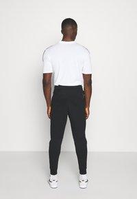 Nike Sportswear - M NSW TCH FLC JGGR - Tracksuit bottoms - black - 2
