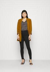 Marks & Spencer London - Jeans Skinny Fit - black denim - 1