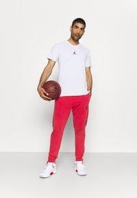 Jordan - AIR PANT - Tracksuit bottoms - gym red/black - 1