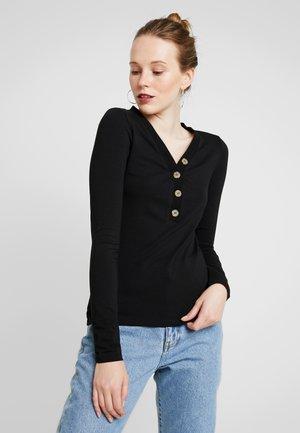 EXCLUSIVE - Long sleeved top - black