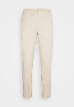 JOGGER - Pantalon classique - stone