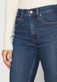GAP Petite - CIGARETTE GLYDE - Slim fit jeans - dark indigo - 4