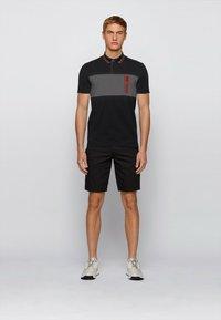 BOSS - PAVEL - Polo shirt - black - 1